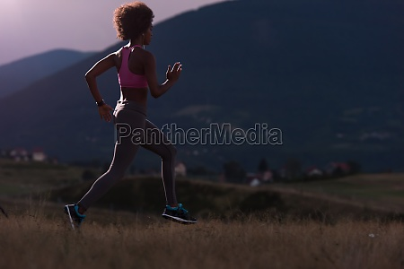 young african american woman jogging in