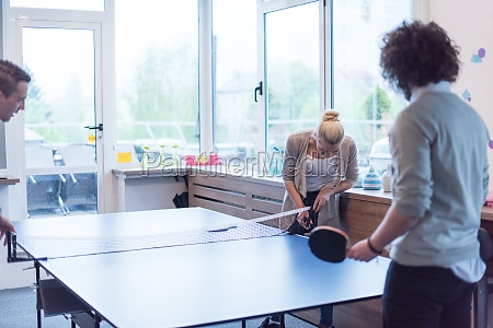 startup business team playing ping pong