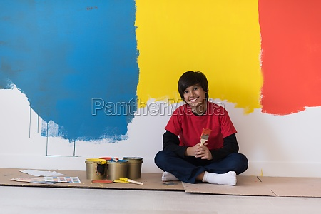 young boy painter resting after painting