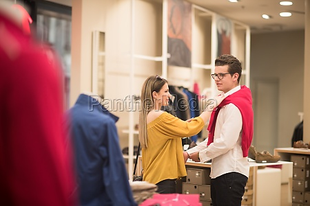 couple in clothing store