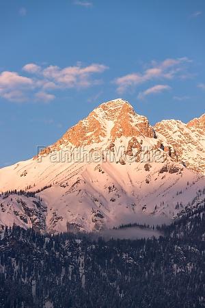 idyllic snowy mountain peaks setting sun