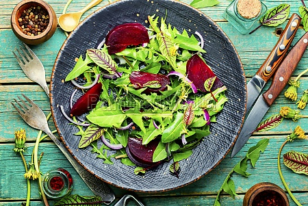 spring greens and beetroot salad wooden