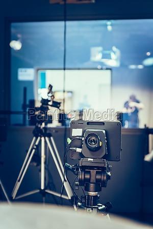 modern film camera on a tripod