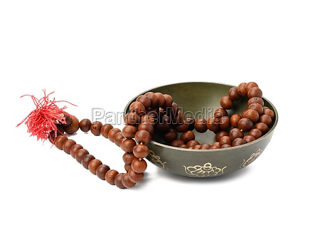 prayer beads and copper singing bowl