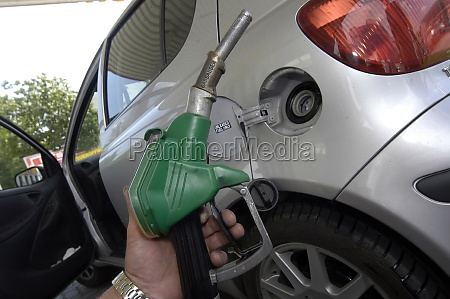 dispenser and tank nozzle when refueling