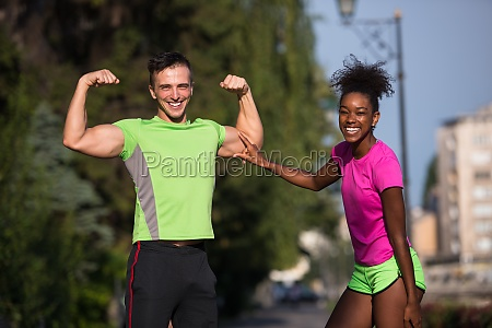 portrait of young multietnic jogging couple