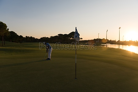 golfer hitting ball to hole