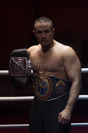 kick boxer with his championship belt