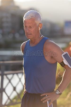 portrait of handsome senior jogging man