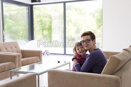 mother and cute little girl enjoying