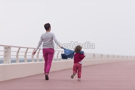 mother and cute little girl on