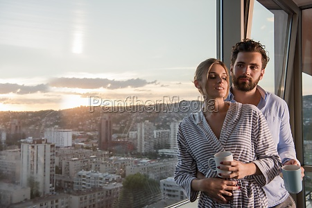 young couple enjoying evening coffee by