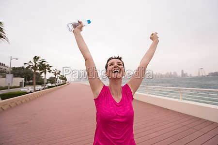 young woman celebrating a successful training