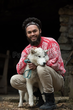 hipster with dog in front of