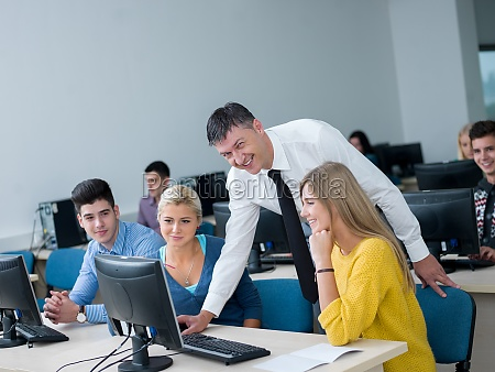 students with teacher in computer