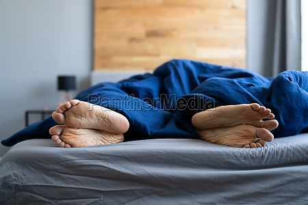 unhappy angry divorce feet in bedroom