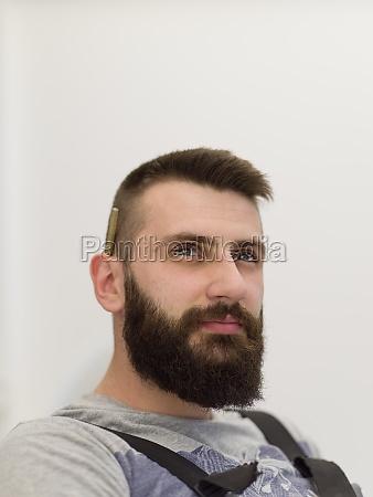portrait of bearded hipster handyman