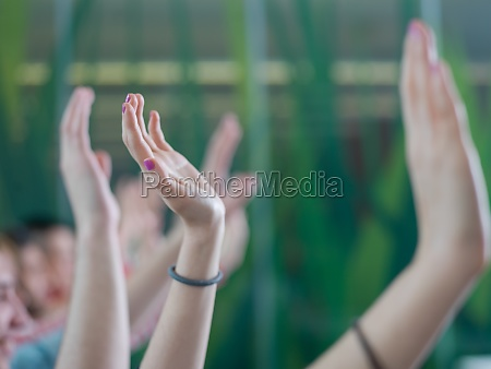 students group raise hands up on