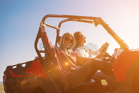 two young women driving a off