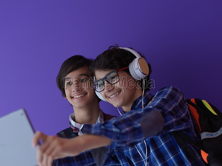 arab teenagers group working on laptop
