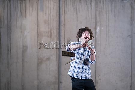 businessman making the rain of money