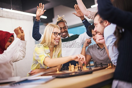 multiethnic group of business people playing