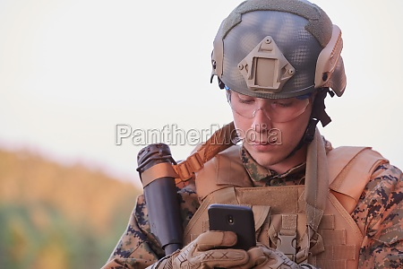 soldier using smart phone