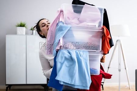 woman decluttering and doing laundry