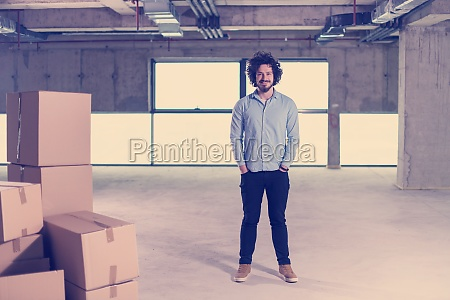portrait of young businessman on construction