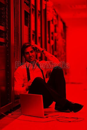 businessman with laptop in network server