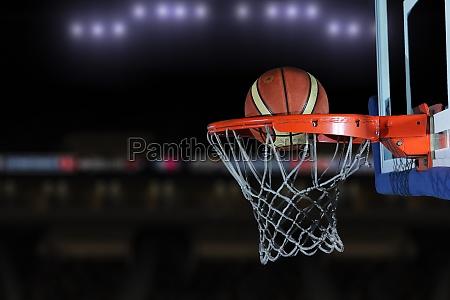 basketball ball and net on grey