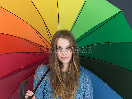 handsome woman with a colorful umbrella