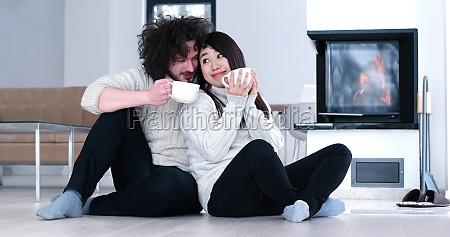 multiethnic romantic couple in front
