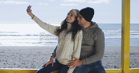 gorgeous couple taking picture of herselfe
