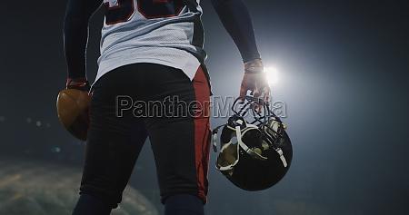 portrait of focused american football player