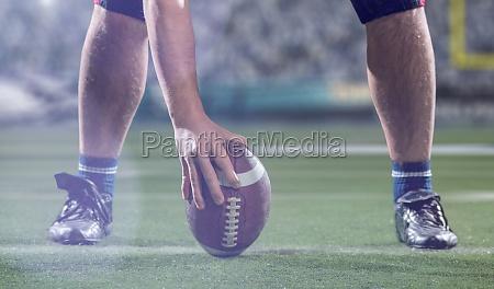 american football player preparing to start