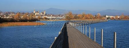 boardwalk leading to rapperswil blue lake
