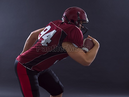 american football player running with the