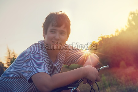 boy in a bicycle outdoors