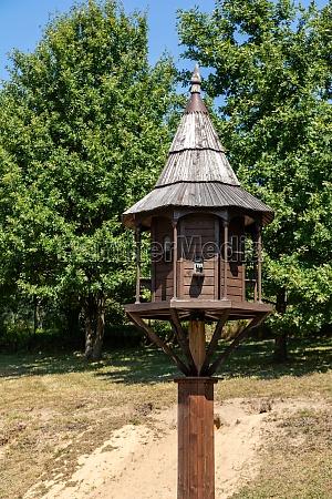 old wooden dovecote in rural garden