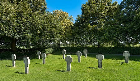 stone crosses on a meadow in
