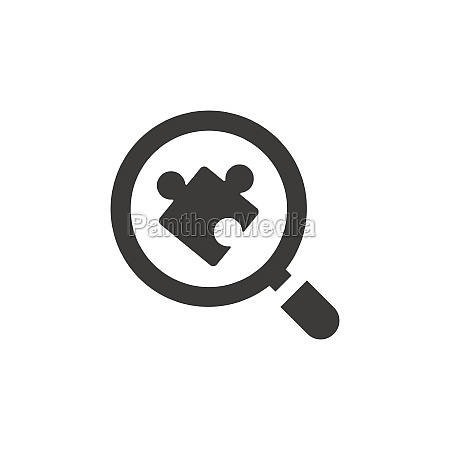 magnifying glass or magnifier with puzzle