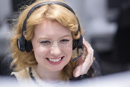 female call centre operator doing her