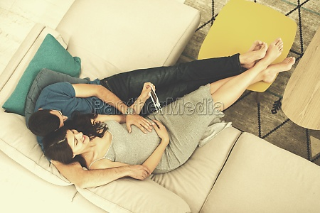 top view of pregnant couple looking