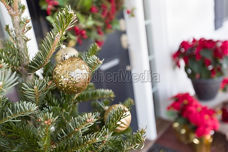 christmas decorations at front door of