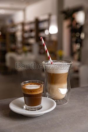 layered cappuccino and long espresso coffee