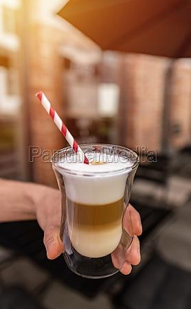 tempting glass of latte macchiato