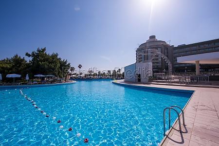 tropical swimming pool in hotel resort