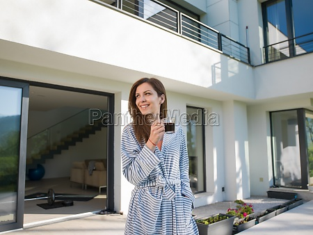 woman in a bathrobe enjoying morning