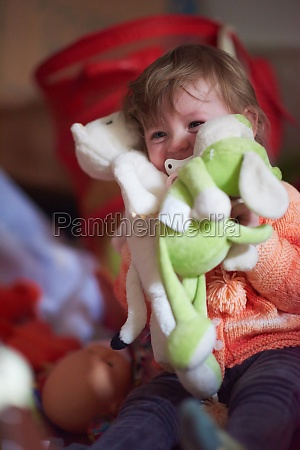 child playing with toys at